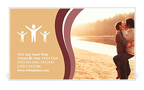 Young beautiful couple in love staying and kissing on the beach on sunset. Soft sunny colors. Business Card Template