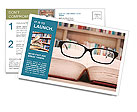 Closeup of reading glasses on the book. shot in the library Postcard Template