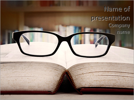 Closeup of reading glasses on the book. shot in the library PowerPoint Template