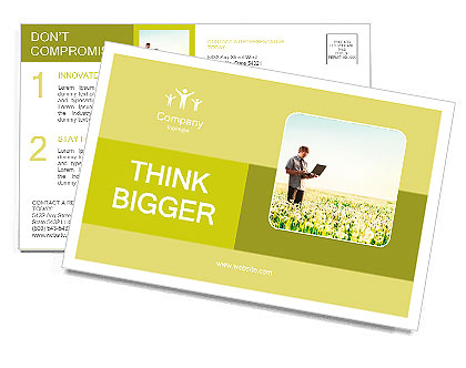 Happy young man with laptop in hand standing on meadow with dandelions Postcard Template
