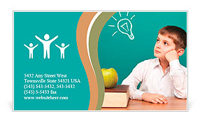 Cheerful little boy sitting at the table. School concept Business Card Template