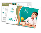 Cheerful little boy sitting at the table. School concept Postcard Template