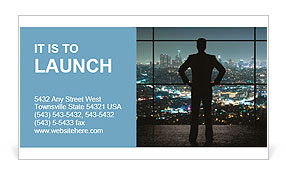 A man in a suit looking at the night city Business Card Template