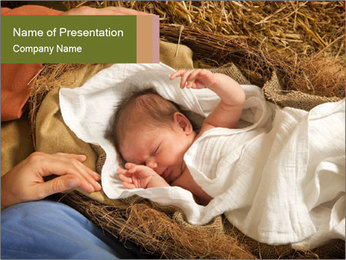 Baby in Chrstmas Crib PowerPoint Template