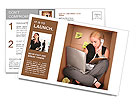 A young business woman is working on a laptop and talking on a phone in a box representing a small o Postcard Template