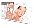 Happy portrait of beautiful young woman with flower on a shoulder applying cosmetic cream on a cheek Postcard Template